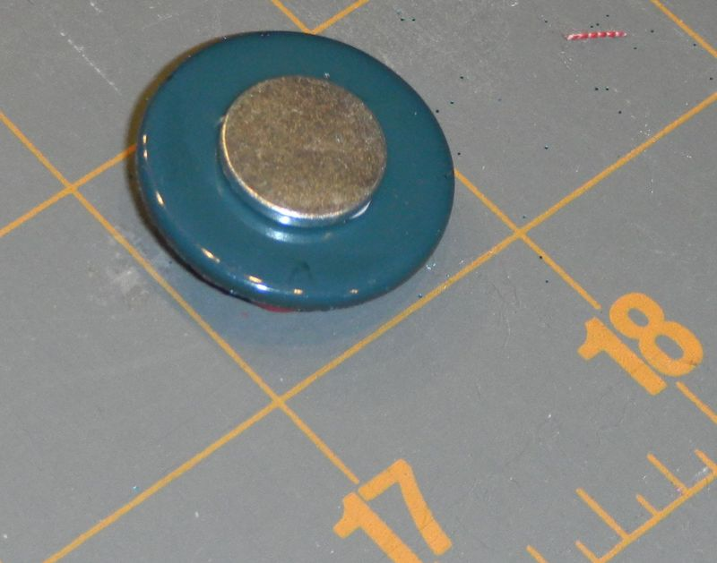 81 Glue magnet to back of button